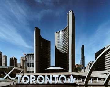 Permanent resident card (PR) card renewal background has Toronto buildings