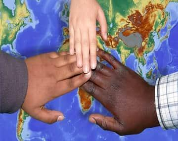 hands of different ethnic people representing Canada's Refugee and Asylum Program