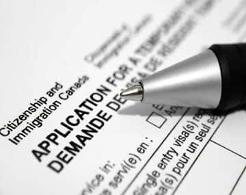 Temporary Residence application form and pen on it